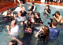 Mark Webber, Sebastian Vettel and most of the Red Bull team take a dip