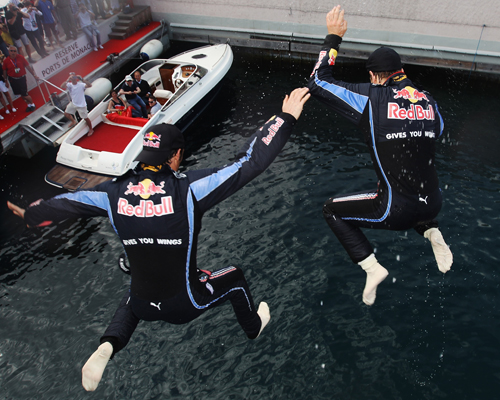 Mark Webber and Sebastian Vettel plunge into the sea