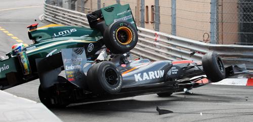 Jarno Trulli's Lotus and Karun Chandhok's HRT collide