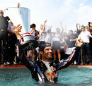 Mark Webber celebrates his win in the Red Bull swimming pool