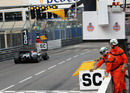 Michael Schumacher makes sedate progress under the yellow flag