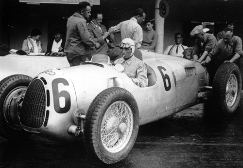 Achille Varzi has a cigarette during a pit stop