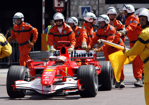 Michael Schumacher is pushed back to the pits after stopping seconds from the end of qualifying