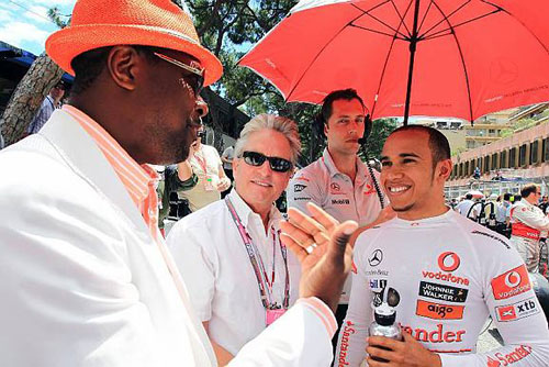Chris Tucker chats to Lewis Hamilton and Michael Douglas