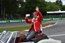 Sebastian Vettel takes a video during the drivers parade