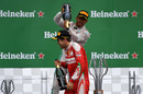 Lewis Hamilton pours champagne on Sebastian Vettel