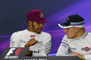 Lewis Hamilton talks with Valtteri Bottas during the press conference