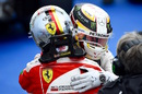 Lewis Hamilton and Sebastian Vettel hug after the race