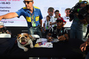 Lewis Hamilton with his dog at the autograph session