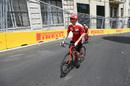 Kimi Raikkonen rides the circuit on a bike
