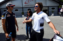 Fernando Alonso talks with Carlos Sainz