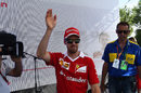 Sebastian Vettel waves to fans at the autograph session