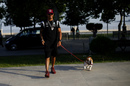 Lewis Hamilton through the paddock with his dog