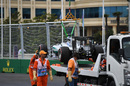 The car of Nico Rosberg is recovered after stopping on track