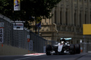 Lewis Hamilton gets the power down in the Mercedes
