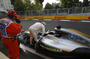Lewis Hamilton leaves his car after crashed in Q3