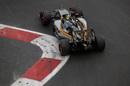 Sergio Perez rides a kerb to round a corner