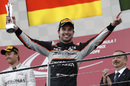 Sergio Perez celebrates on the podium with the trophy