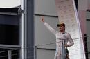 Nico Rosberg celebrates his win on the podium
