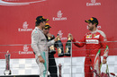 Nico Rosberg and Sebastian Vettel celebrate on the podium
