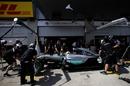 Lewis Hamilton returns to the pitbox