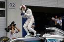 Race winner Lewis Hamilton cereblates in the parc ferme