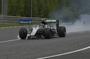 Nico Rosberg with broken front wing on the last lap