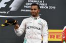 Lewis Hamilton smiles on the podium