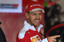 Sebastian Vettel smiles in the garage
