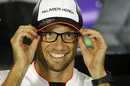 Jenson Button wears glasses in the press conference