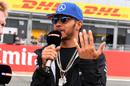 Lewis Hamilton speaks to media