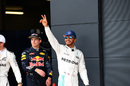 Lewis Hamilton celebrates taking pole position in his home race