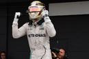 Lewis Hamilton celebrates taking pole position in parc ferme