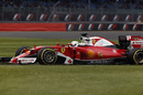 Sebastian Vettel works hard to keep his pace