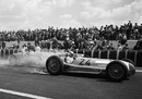 Rudolf Caracciola lights up the rear tyres of his Mercedes W154 off the line