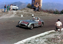 Stirling Moss on his way to victory at the Mille Miglia