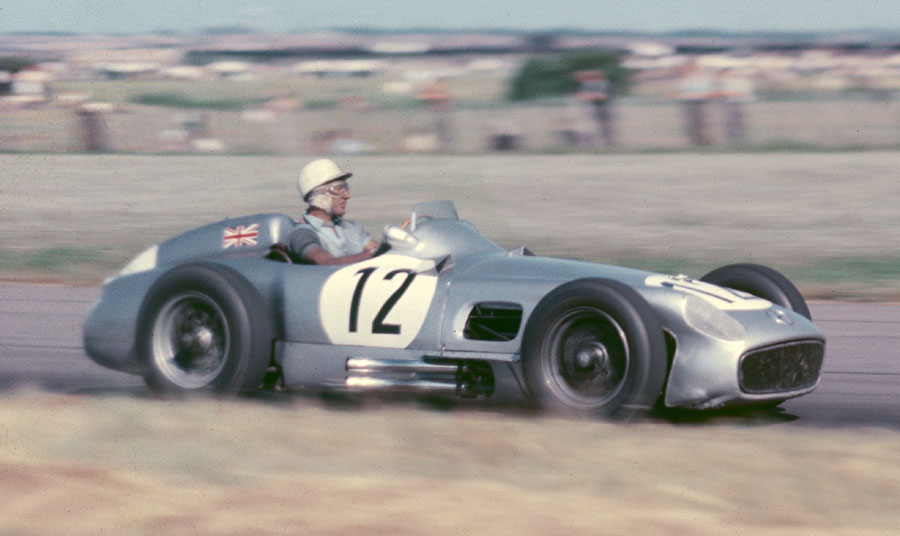 Stirling Moss guides his Mercedes to victory
