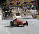 Juan Manuel Fangio holds on to a huge slide coming out of Tabac