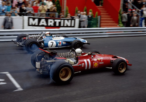 Chris Amon and Jackie Stewart vie for position away from the start