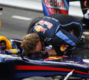Sebastian Vettel checks his car following the Monaco Grand Prix, May 16, 2010