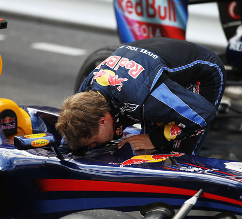 Sebastian Vettel checks his car following the Monaco Grand Prix