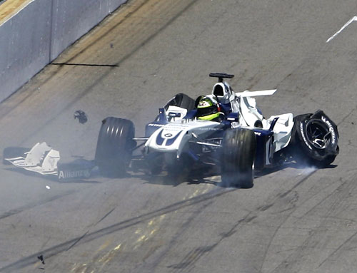 Ralf Schumacher spins away after hitting the wall during the United States Grand Prix