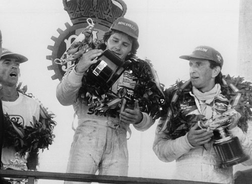 Gilles Villeneuve celebrates winning the Spanish Grand Prix