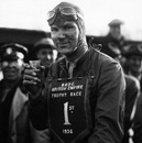 Dick Seaman, winner of the British Empire Trophy Race at Donington Park, celebrates with a drink