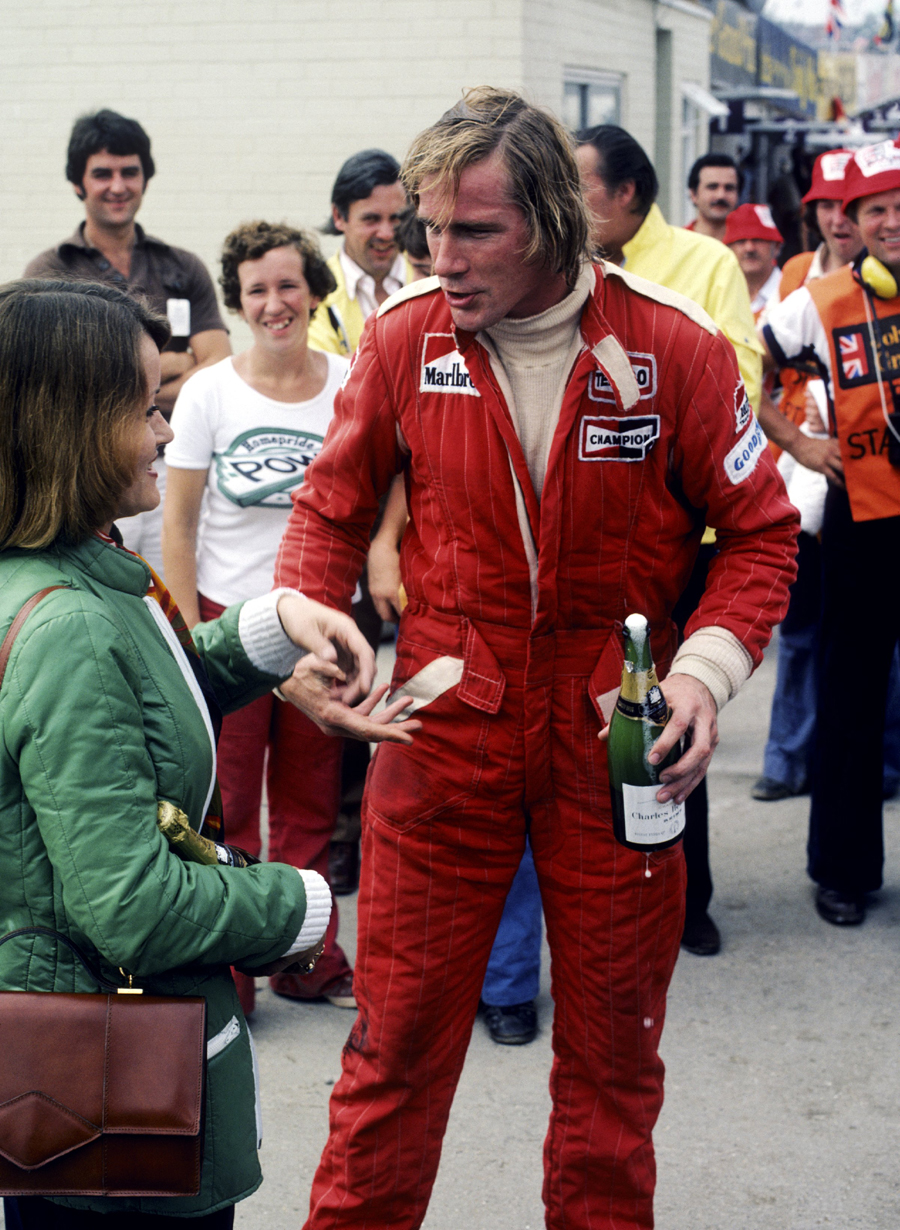 James Hunt celebrates victory at the British Grand Prix - disqualification came later