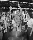 Bill Vukovich celebrates his win at the 1953 Indianapolis 500