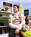 Indianapolis 500 pole-sitter Tony Stewart watches teammate Robbie Buhl circle the track