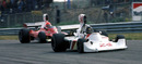 James Hunt leads Niki Lauda on the way to his maiden victory