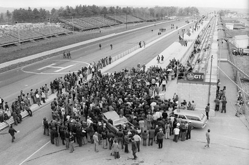 An early morning Sunday church service conducted in the pits after the tragic death of Francois Cevert