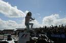 Lewis Hamilton celebrates his win in parc ferme